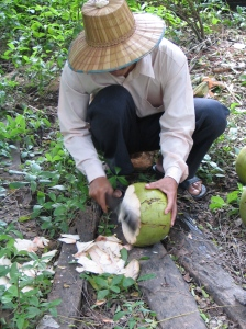 Pastor Soy opening a coconut (that's a sharp machete!).